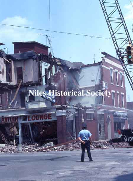 Photographs showing the demolition of the Allison Building in 1976 during urban renewal.