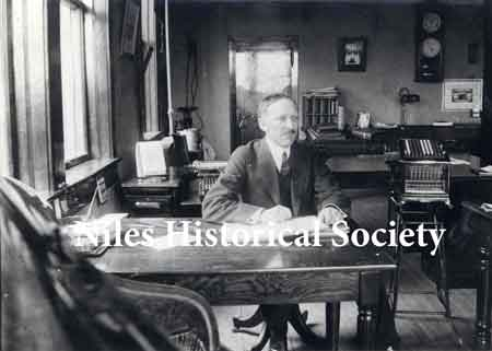 Mr. C. E. Rose, secretary and treasurer of Niles Car & Manufacturing Co. at his desk in the company office about 1912