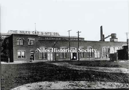 Erie Street view of the Niles Car & Manufacturing Co., makers of one of the finest lines of plush electric cars of the area