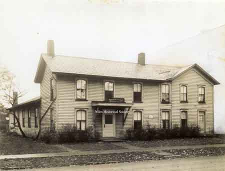 A photo of the Parish House of First Christian Church which was purchased in 1918 and razed in 1966.