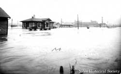 The streetcar waiting station on Robbins Aveenue during the 1913 flood.