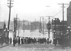 Main Street looking south from Mill Street during flood, March 1913.