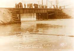 Erie railroad bridge at Church Street in Niles during the Flood of 1913 in March.