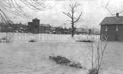 A photo of a view from First Street looking across the river to the north during the 1913 flood.