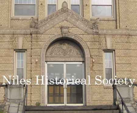 The image to the left shows the detail of the front entrance to the Masonic Temple.