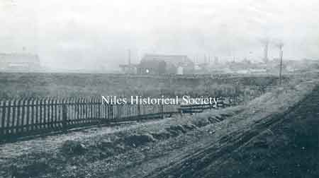 "Smoky industrial skyline of Niles at the peak of iron manufacturing, descibed by historian Howe in 1888 as ""among the most extensive in the state."""