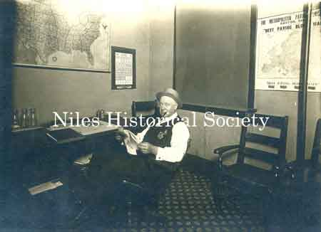 1915 photo taken of Howard Ohl, Sanitary Police, in his city building office.