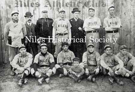 Members of the Niles Athletic Club. Seated: Davy Smith. Standing: unknown, Bill Pritchards, unknown, Police Chief Nicholas, Billy Thomas, unknown, unknown. Mascot: Jacky Phillips.