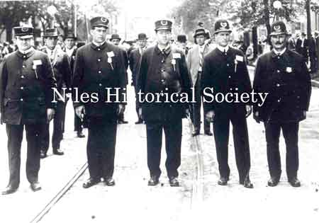 Niles Police leading a parade. L to R: