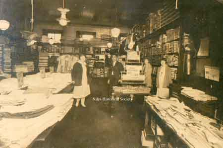 Interior photograph, 1935 ca, of the Shaker store with Isaac in the center.