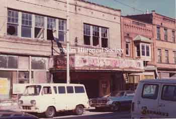 The Warner Theater fell into disrepair as evidenced by the photographs taken in 1975; later the building was demolished in 1976 during urban renewal.