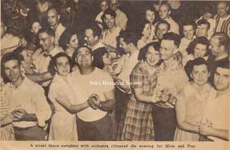 A street dance, with music climaxed the evening for Mom and Pop. Ray Sanfrey is in the front row with white t-shirt.
