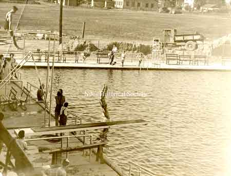 "The pool was dedicated Wednesday July 25,1934. The newspaper stated,"" to several thousand swimming enthusiasts of the city, today marks a noted change from an unsanitary dirtied water creek swimming hole to the most modern and up-to-date pool."""